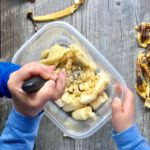 kids mashing bananas in a plastic container