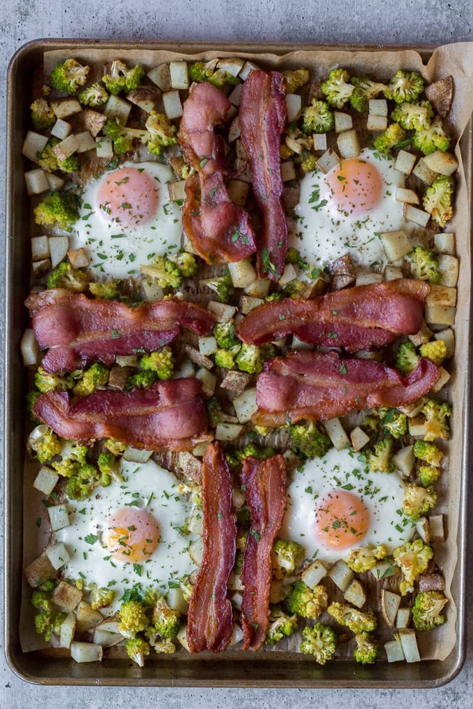 top down view of cooked easy sheet pan breakfast with eggs, bacon, potatoes, and romanesco