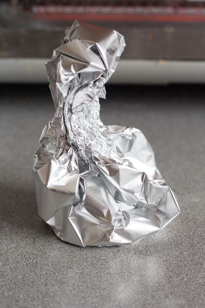 wrapped up aluminum foil containing garlic, salt, and oil