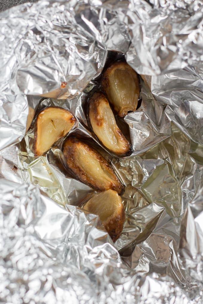 roasted garlic in oil in aluminum foil