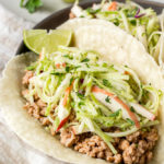 paleo ground pork tacos with lime on a plate