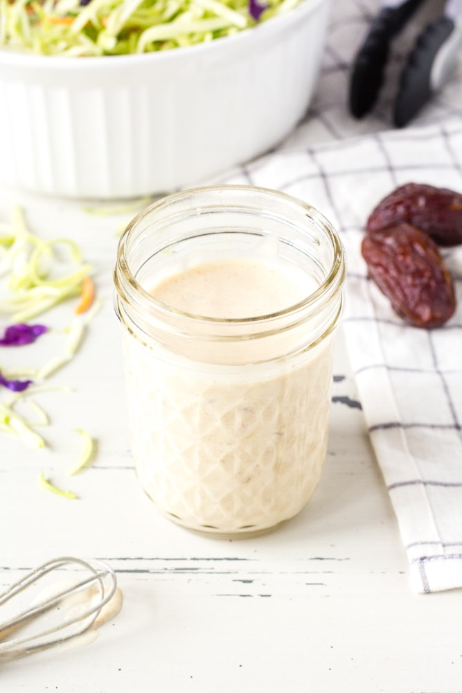 healthy paleo coleslaw dressing in a jar with slaw accompaniments