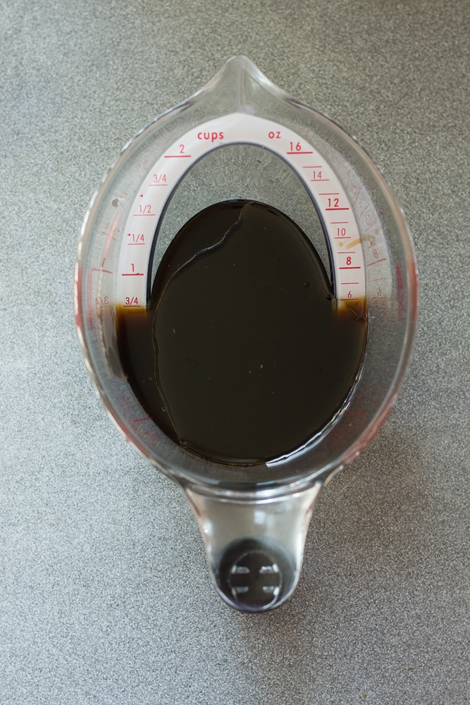 liquid measure cup with coconut aminos and balsamic vinegar