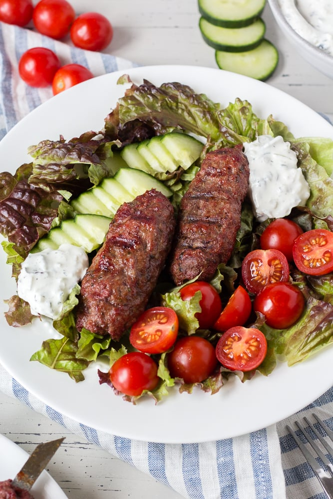 lamb salad on a white plate