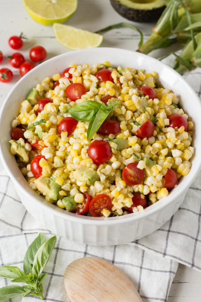corn tomato salad in a white bowl