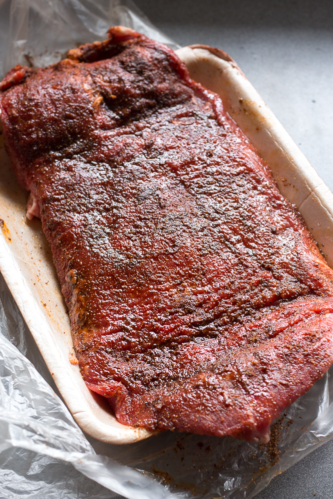 flank steak with dry rub and oil on it