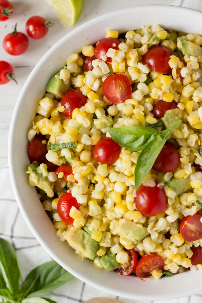 close up of grilled corn salad with tomatoes