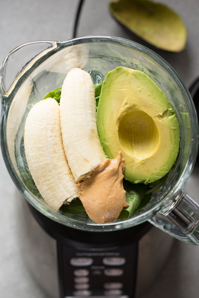 ingredients for spinach smoothie in a blender