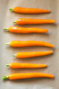 oiled and salted carrots on sheet pan