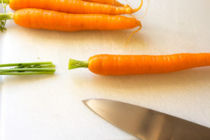 cutting tops off carrots