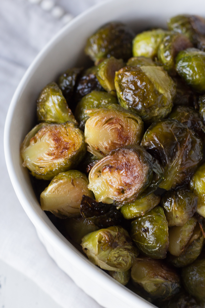 roasted brussels sprouts in a white dish