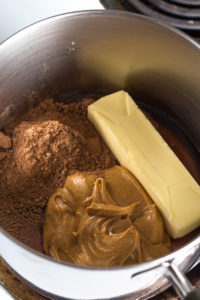 butter, peanut butter, cocoa powder in a pan