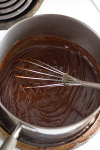 chocolate mixture in a pan with a whisk
