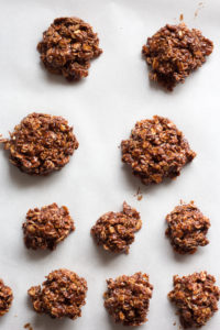 no bake chocolate oatmeal peanut butter cookies on a sheet pan