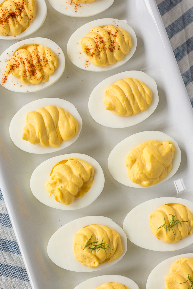top down shot of instant pot deviled eggs on a white platter