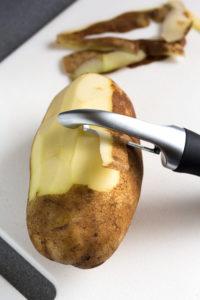 peeling russet potatoes