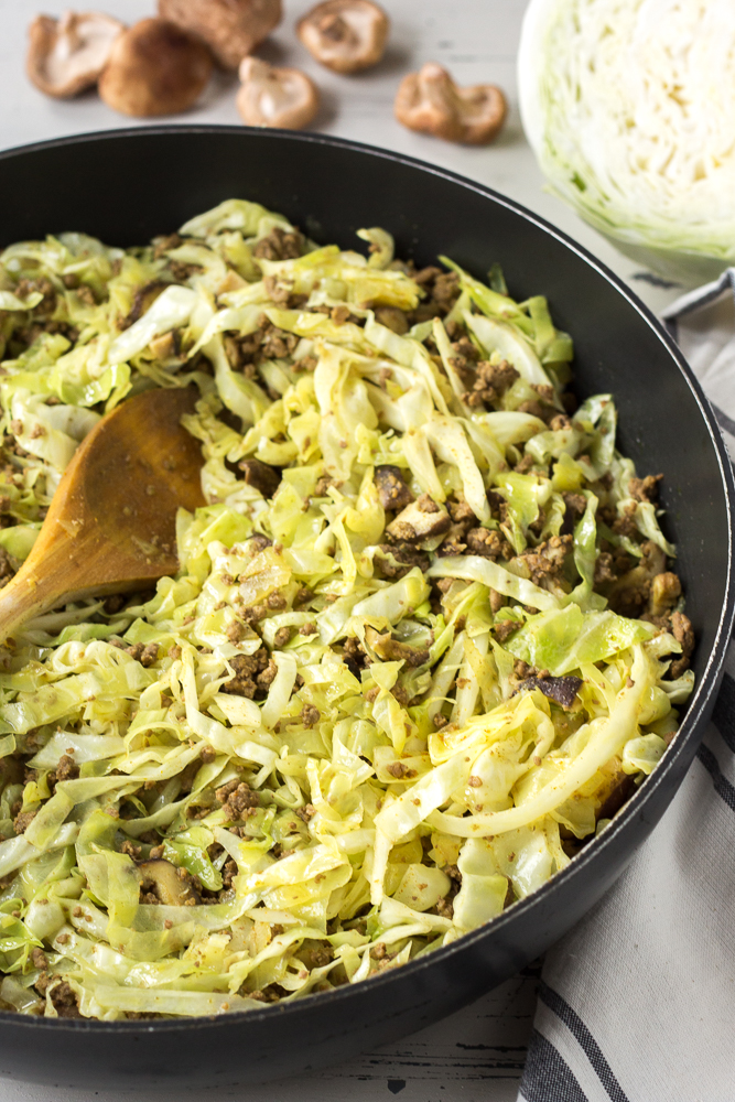 ground beef and cabbage stir fry in a pan
