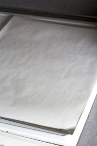 a cookie sheet with parchment paper on it
