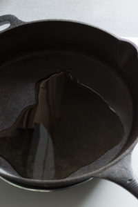 a cast iron skillet with oil in it