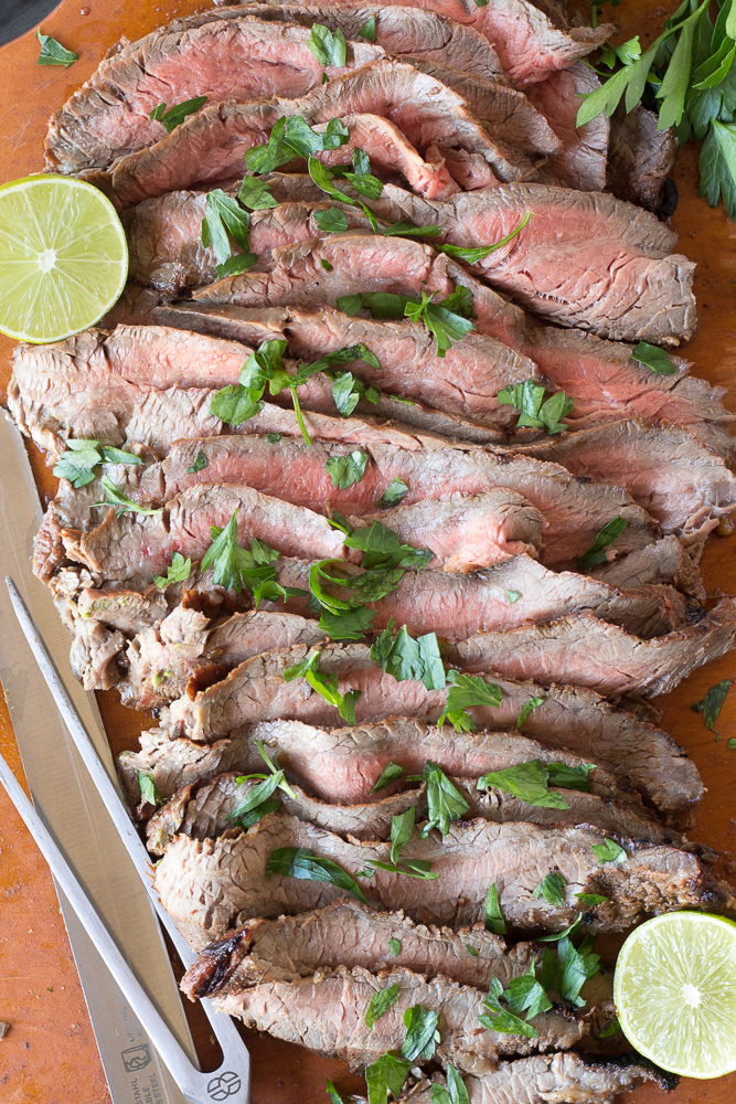 strips of grilled flank steak on a cutting board