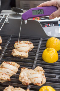 measuring internal temperature of grilled chicken