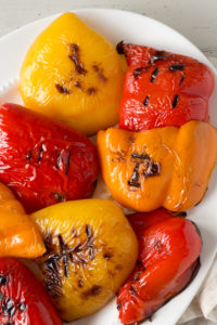 grilled bell peppers on a white platter