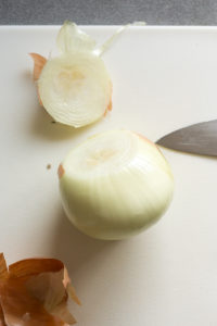 cutting the end off an onion