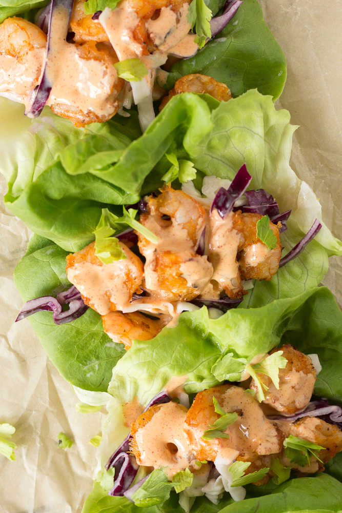 top down shot of whole30 grilled shrimp tacos in lettuce