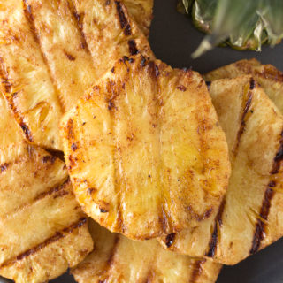 healthy grilled pineapple slices on a plate
