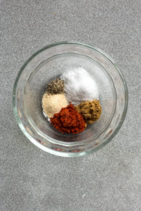 top down shot of spices in a small glass bowl