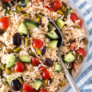 bowl of greek rice salad with a spoon