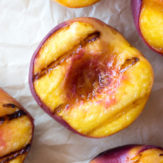 halved grilled peaches
