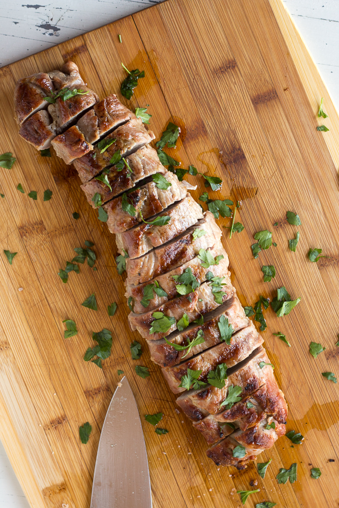 sliced pork tenderloin on a cutting board