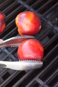 putting peach halves flesh side down on a grill