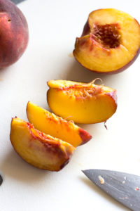 peaches being cut into eight pieces