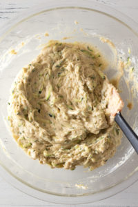 mixed zucchini muffin batter in a bowl