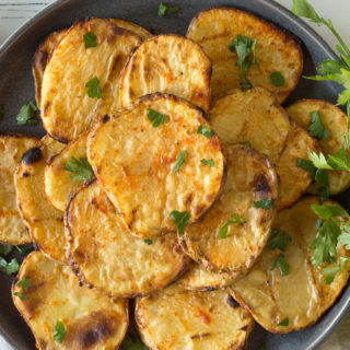 a plate of grilled potatoes