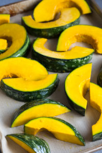 sliced kabocha squash on a sheet pan