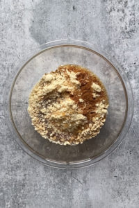 pear crisp topping ingredients in a large clear bowl