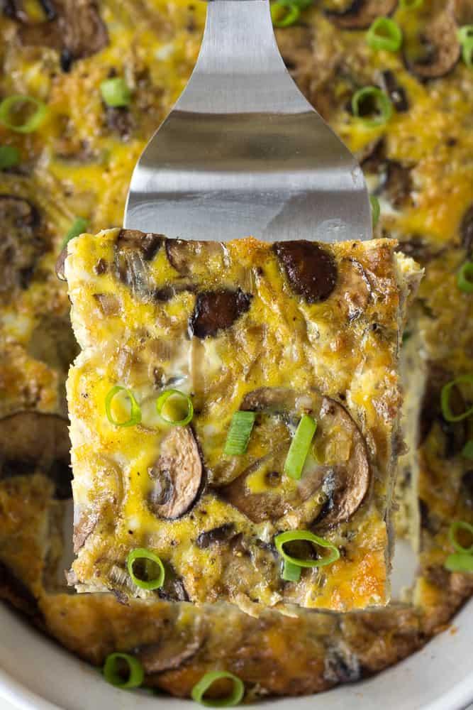 a piece of sausage and egg casserole on a spatula