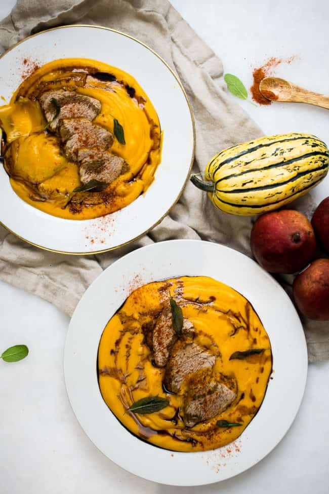 top down shot of sazon pork loin with butternut yuca puree in a bowl