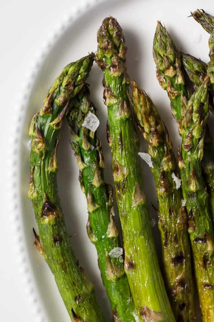 easy grilled asparagus on a white platter