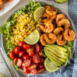 top down shot of grilled shrimp and corn salad in a bowl