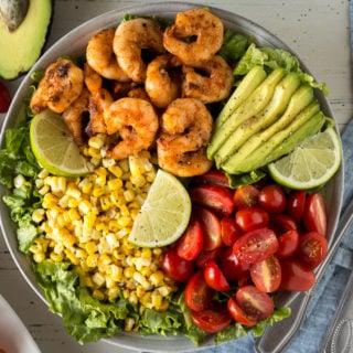 top down shot of grilled shrimp salad in a bowl